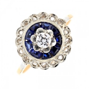 Bague ronde diamants 0.23 carat et saphirs 0.18 carat en or bicolore