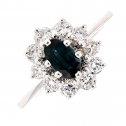 Bague marguerite saphir et diamants 0.60 carat en or blanc