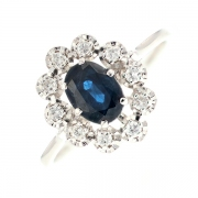 Bague marguerite saphir 1 carat et diamants 0.15 carat en or blanc