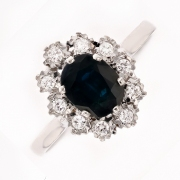 Bague marguerite saphir et diamants 0.20 carat en or blanc