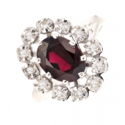 Bague marguerite grenat et diamants 0.12 carat en or blanc