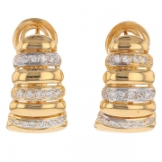 Boucles d'oreilles godrons et diamants 0,30 carat en or bicolore