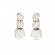 Boucles d'oreilles trilogie de diamants 0.53 carat en or blanc