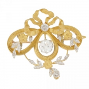 Broche noeud diamants 0,80 carat sur or bicolore
