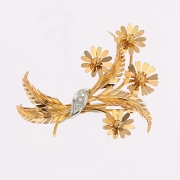 Broche bouquet de fleurs diamants en or bicolore 7.14grs