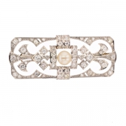 Broche diamants 1.50 carat et perle en or blanc et platine