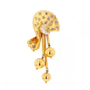 Broche noeud saphirs et diamants en or jaune