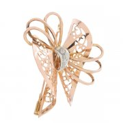 Broche noeud vintage diamants 0,09 carat en or rose et or blanc