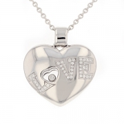 Pendentif coeur signé CHOPARD LOVE diamants 0.45 carat en or blanc